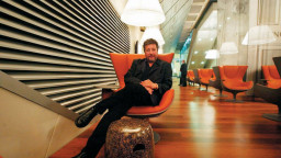 Philippe Starck at the Eurostar Lounge he designed in Waterloo, England