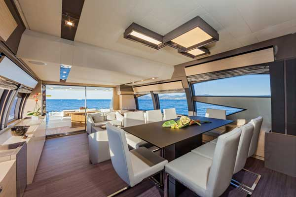 A view of the Ferretti 750's stylish deck salon, with its substantial windows, clean lines and designer furnishings