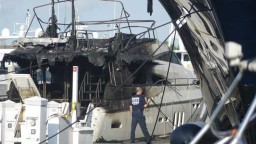 (Joe Cavaretta / Sun Sentinel)  Severely damaged yacht at Bahia Mar as seen on Thursday, Aprl 23, 2015, the morning after fire broke out.