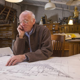 In the privacy and comfort of his pleasantly cluttered home studio in Providence, Rhode Island, Eugene Lee steals a few moments from stage set design to pore over line drawings of his boats.