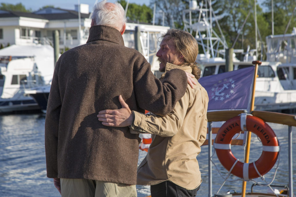 Lee and Dominic Zachorne, longtime friends and boat partners, discuss the posterity of the fleet while walking the docks at Wickford Shipyard.