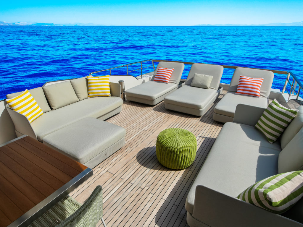 Paola Lenti lounges, including a green tuffet, accent the upper deck.
